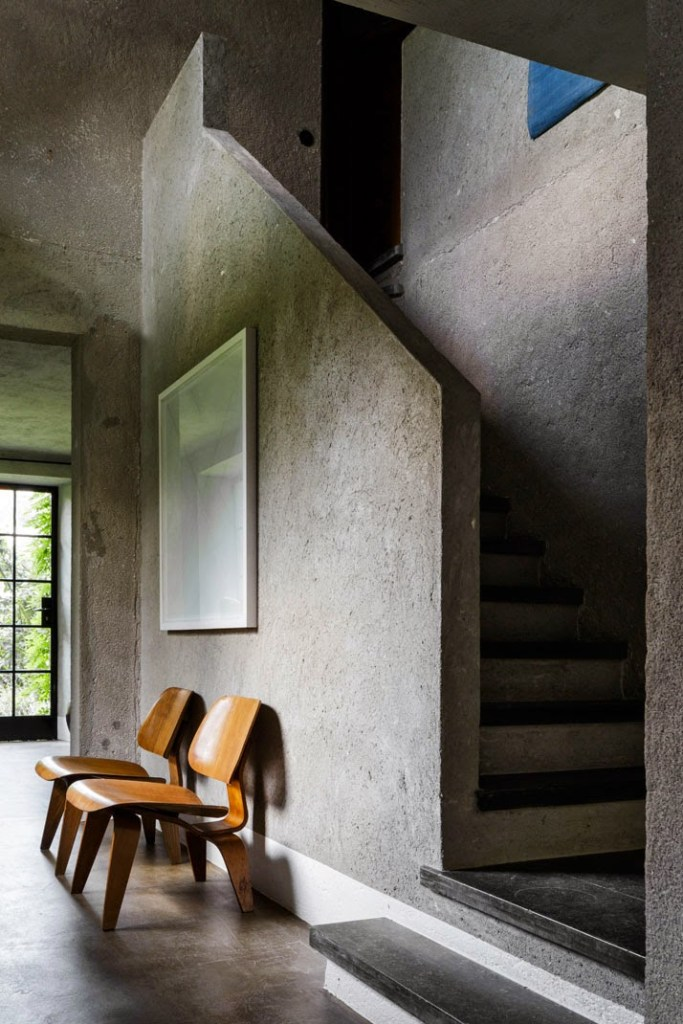 Coarse concrete walls in this small Belgian boutique hotel Bea BandB in seaside resort Knokke. The owner is a vintage design collector and everything is for sale, including these Eames LCW chairs - via Automatism