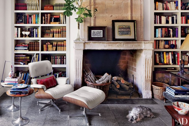 Lovely Eames Lounge Chair at the fireplace in interior designer Isabel Lopez-Quesada's Madrid home, I spy some vintage Saarinen occasional tables too, great mix of Mid Century and Ecclectic
