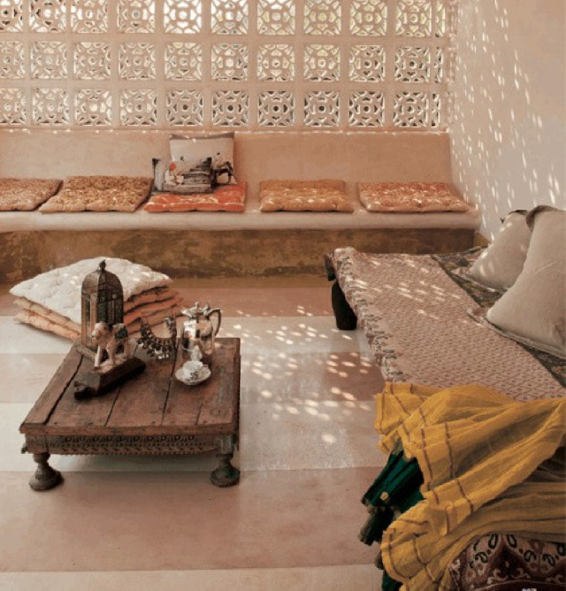 An earthy color palette in this Arabic shaded outdoor space - via Pure Home