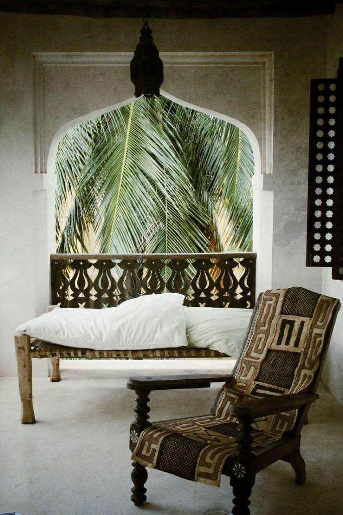 Arabian architecture, Indian daybed and African planter's chair with a tribal cover - via Love.Repeat.