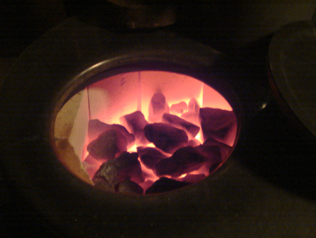 The sauna stove stones glowing cherry red.