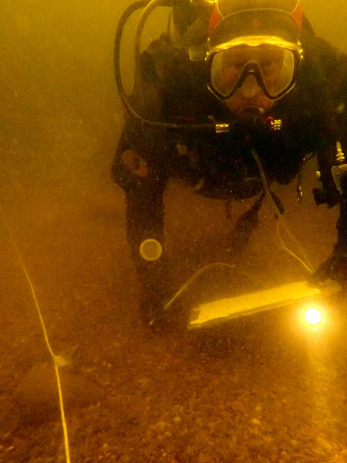 Me surveying a grid in Ruumiinmatala, The Corpse Shallows. (Photo: Metsähallitus).