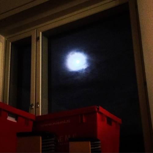 Last night in the old apartment. Just me, full moon, someone else's moving boxes and the steady murmur of traffic I've listened to so many nights in the former work room.