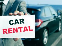 guy-holding-a-car-rental-sign-dp