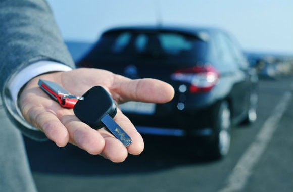 Handing Over the Keys of a Rental Car