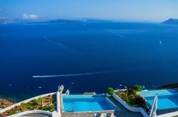 Admiring the view from a luxury hotel in Santorini