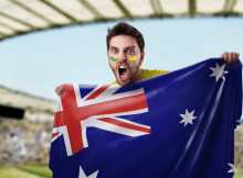 man cheering for his favourite team while holding AU flag