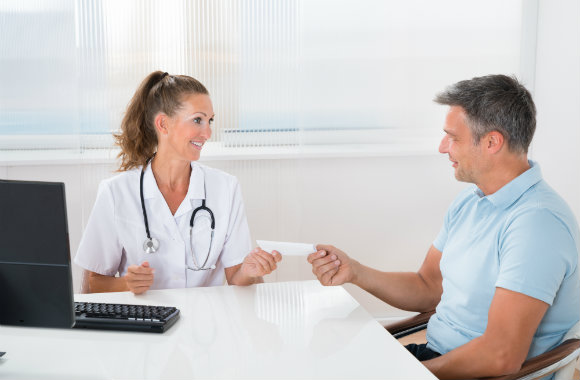 man getting medicine prescription from his doctor