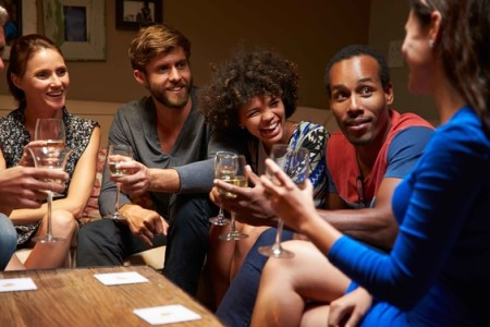 A happy group of young adults at a house party