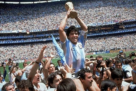 Maradona celebrating with the 1986 World Cup