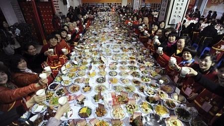 a long table set with spring festival food