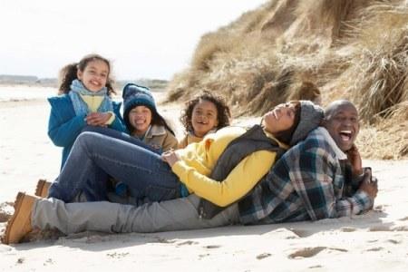 A black family on a beach vacation