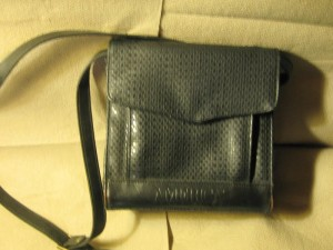 straight, structured purse best for someone with undefined waist and angular face shape