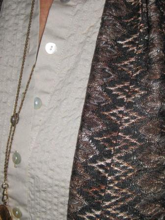 textured vest over textured tunic