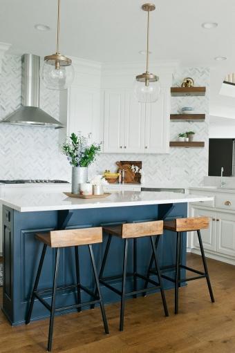 kitchen with navy blue island