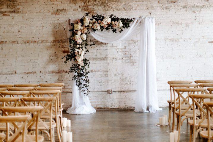 Image of Interior of Brake and Clutch Warehouse, Dallas Wedding Venue. Floral centerpiece.