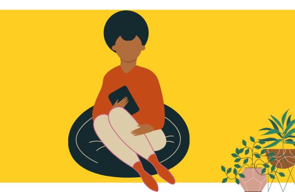 black girl reading on carpet