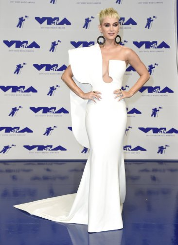 Lovato wears black lace, Katy Perry changes up looks at VMAs