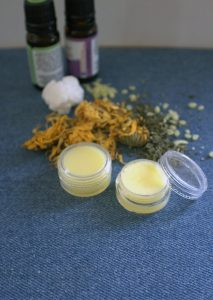DIY Herbal Lip Balm For Chapped Winter Lips | With chapped lips, you reach for that tube of lip balm you bought at the drugstore or health food store. Sure, it feels better, but what if you're going through several expensive tubes this season? Is there a cheaper or more natural way? | WildernessFamilyNaturals.com