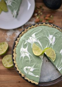 Raw Avocado-Lime Tart {no eggs, grains, gluten, dairy, or sugar} | This raw tart recipe is an elegant crowd-pleasure. It not only looks beautiful, but it's full of enzymes from soaked almonds and pumpkin seeds, healthy fats from coconut milk, coconut oil, and avocado, and detoxifying properties from the spirulina. | WildernessFamilyNaturals.com