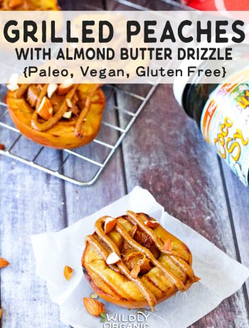 A photo of grilled peaches topped with almond butter drizzle and chopped almonds.