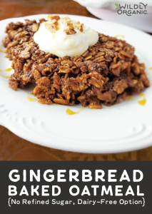A photo of gingerbread baked oatmeal on a plate topped with pecans, greek yogurt and coconut syrup.