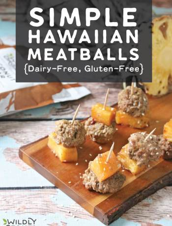 A photo of simply hawaiian meatballs and pineapple on toothpicks on a serving platter.