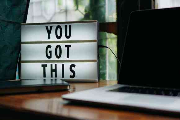 An image of text saying You Got This next to a computer, encouraging you to automate your business tasks.