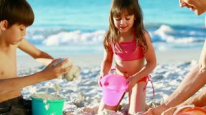 stock-footage-father-and-his-children-building-sand-castles-on-the-beach