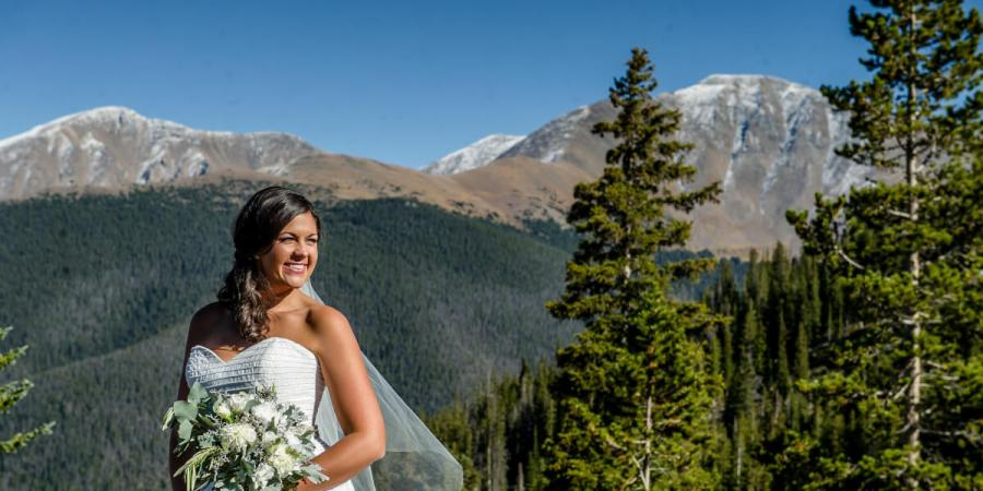 Winter Park Resort Bride smiles with Parry's Peak in the background