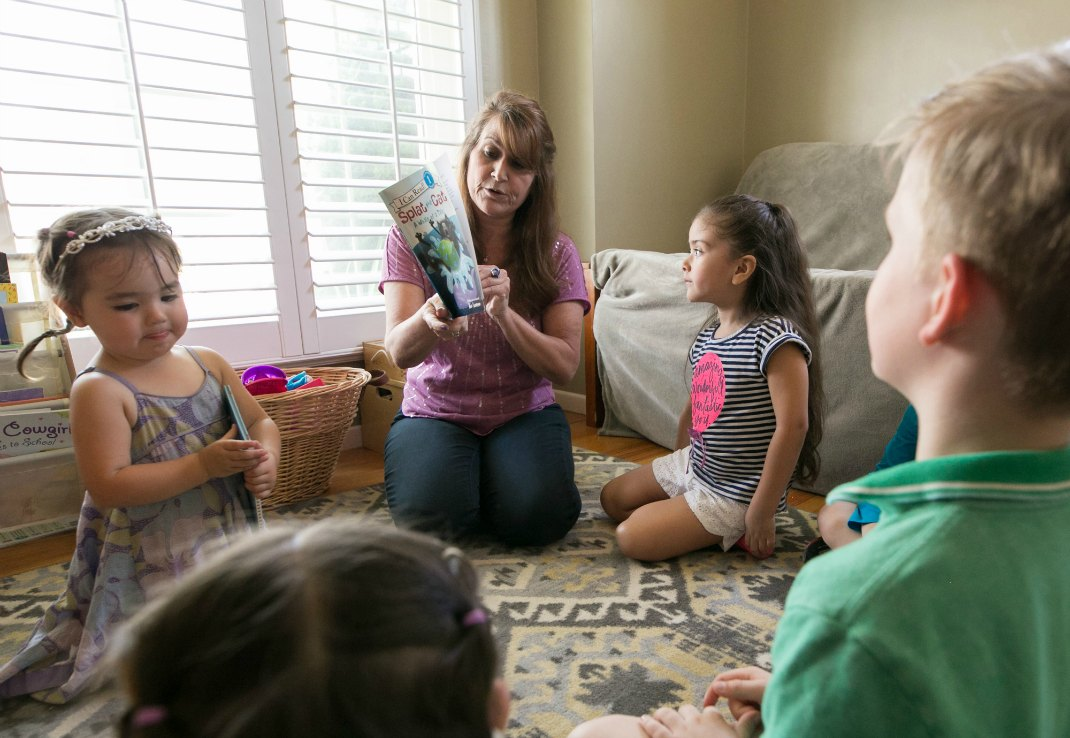 Reading at Pride & Glory Montessori in-home preschool