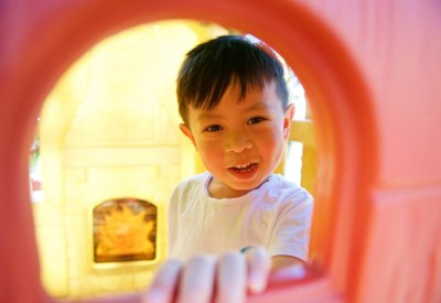 Child through window playing at Little Butterfly Small School, in-home preschool