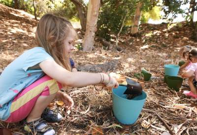 Benefits of forest school: playing in mud