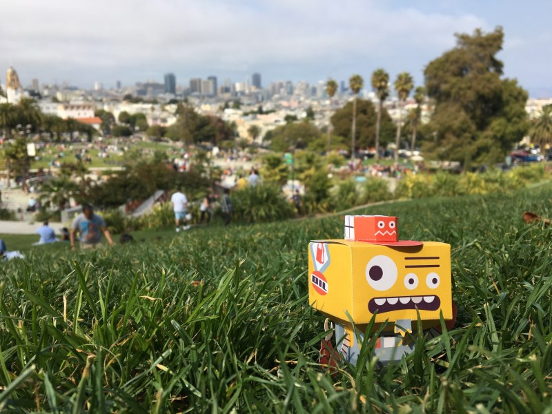 ERR-07 enjoying the view of the city from Dolores Park—before impressing friends with his signature grease burgers.