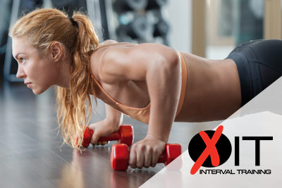 Woman doing a pushup with hand weights