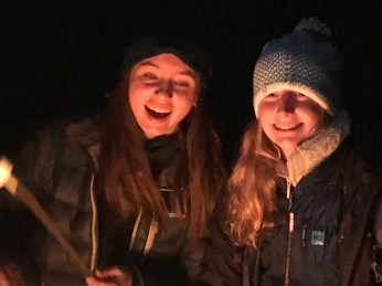 Sofia and Tera at the campfire