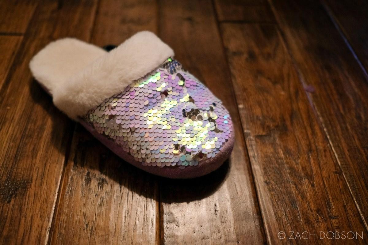 kids sequin slipper on hardwood floor