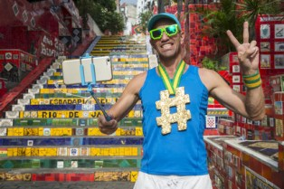 Hashtag gold medal athlete takes a selfie in front of the colorful Selaron Steps in Rio de Janeiro, Brazil