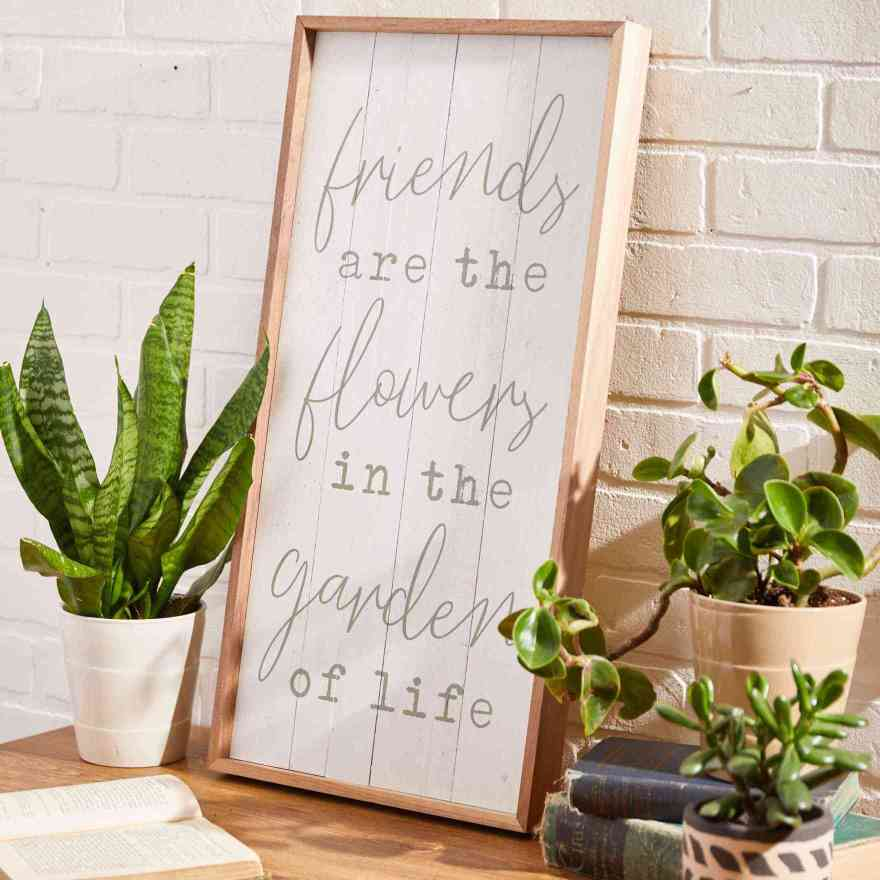 sign reading friends are the flowers in the garden of life
