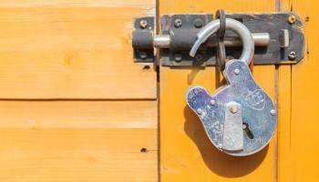 An opened lock on a door