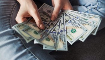 earn money, a person holding cash
