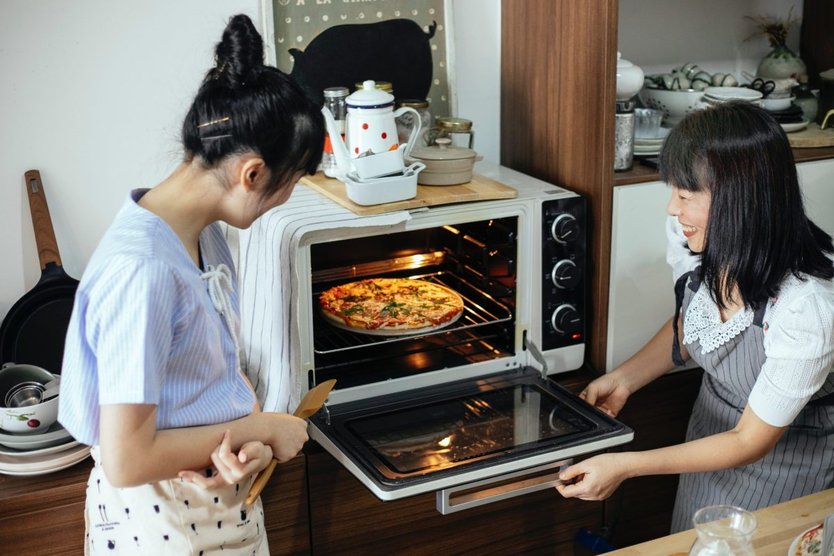 two women sharing a kitchen