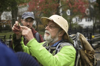 a man clicking a photograph in nyc