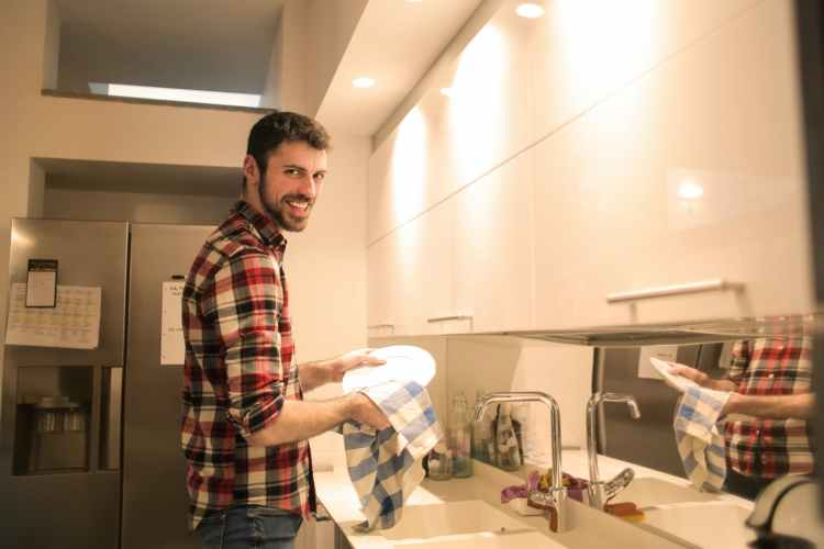 A man doing the dishes.