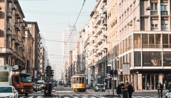 Tram passing through a neighborhood in Milan with rooms for rent
