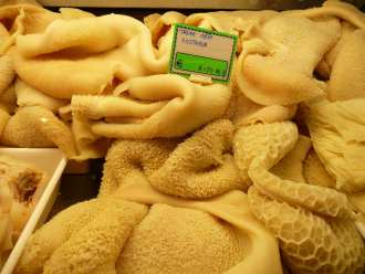 piles of tripe in an Italian butcher are some of Italy's most esoteric cuisine.
