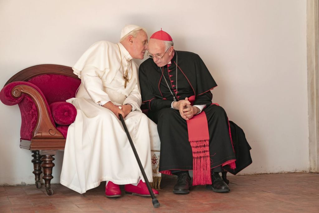 Antony Hopkins and Jonathan Pryce as Pope Francis and Pope Benedict. Image courtesy of Studio Lucherini Pignatelli.