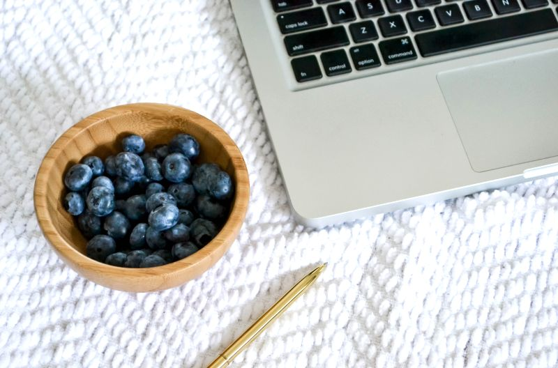 laptop and blueberries