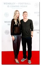 MUNICH, GERMANY - AUGUST 19: German football player Bastian Schweinsteiger (R) and his girlfriend Sarah Brandner arrive for the Wembley: Football Is Coming Home - Premiere on August 19, 2013 in Munich, Germany. (Photo by Johannes Simon/Bongarts/Getty Images)