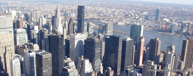 Manhattan, la Gran Manzana de Nueva York. Juangla de rasca cielos de hormigón, acero y cristal